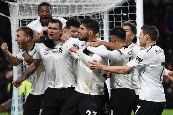Klavan Liverpool esultanza gruppo