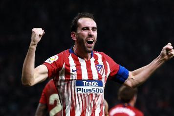 Godin esulta braccia larghe Atletico Madrid