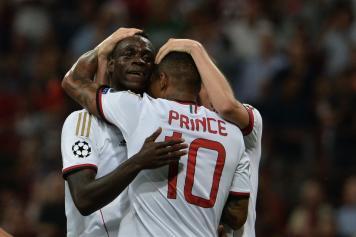 Balotelli.Boateng.Milan.2013.14.abbraccio.jpg GETTY IMAGES