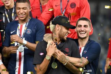 Neymar.Verratti.Mbappe.PSG.festa.2019.20.jpg GETTY IMAGES